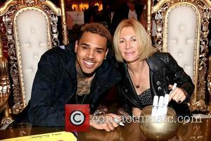 Chris Brown and Karen Bystedt - Chris Brown and Karen Bystedt Exclusive Serigraph Signing Benefit Symphonic Love Foundation at Guerilla...