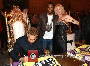 Chris Brown, Trey Songz and Karen Bystedt - Chris Brown and Karen Bystedt Exclusive Serigraph Signing Benefit Symphonic Love Foundation...