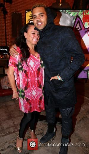 Joyce Hawkins and Chris Brown - Chris Brown and Karen Bystedt Exclusive Serigraph Signing Benefit Symphonic Love Foundation at Guerilla...