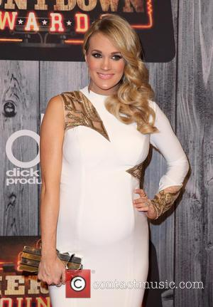 Carrie Underwood Broke Into Her Own Car To Rescue Her Son & Dogs