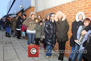 Fans - Union J sign copies of their new album 'You Got It All' at Morrison supermarket at Morrisons Rothwell...