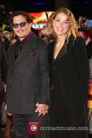 Johnny Depp, Amber Heard, Johnny Depp and Amber Heard - The UK premiere of 'Mortdecai' held at the Empire cinema...