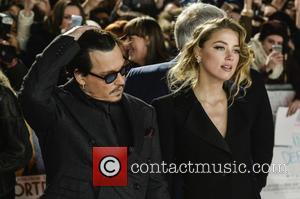 Johnny Depp and Amber Heard - Celebrities  attends Mortdecai at the Empire Cinema in Leicester Square. at Empire Cinema...