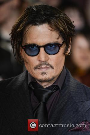 Johnny Depp - Celebrities  attends Mortdecai at the Empire Cinema in Leicester Square. at Empire Cinema - London, United...