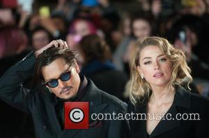 Johnny Depp and Amber Heard - A host of stars were photographed as they attended the UK premiere of 'Mortdecai'...