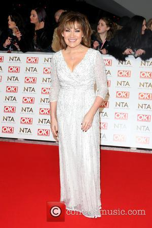 Lorraine Kelly - A host of British television stars were photographed on the red carpet at The National Television Awards...
