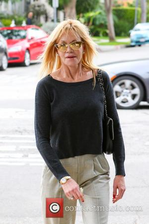 Melanie Griffith - Melanie Griffith wearing gold mirrored retro sunglasses, has lunch with a a male companion in West Hollywood...