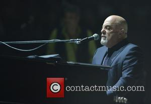 Shots of American singer songwriter Billy Joel as he gave a live performance at the American Airlines Arena in Miami,...
