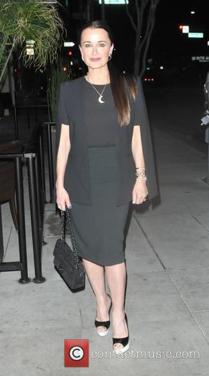 Kyle Richards - Kyle Richards and Guraish Aldjufrie have dinner at The Palms in Beverly Hills at Beverly Hills, Ca...