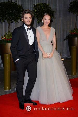 Sam Claflin and Laura Haddock - A variety of stars were photographed at the EE British Academy of Film and...
