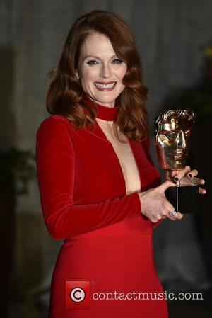 Julianne Moore - A host of stars were photographed as they attended the EE British Academy of Film and Television...