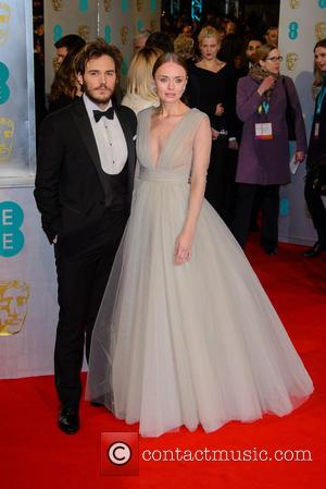 Sam Claflin and Laura Haddock - Various stars of film and television were photographed on the red carpet as they...