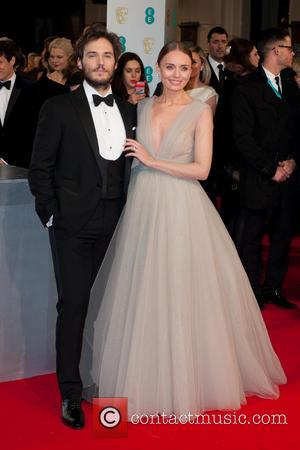 Sam Claflin and Laura Haddock - EE British Academy Film Awards (BAFTA) at The Royal Opera House - Red Carpet...