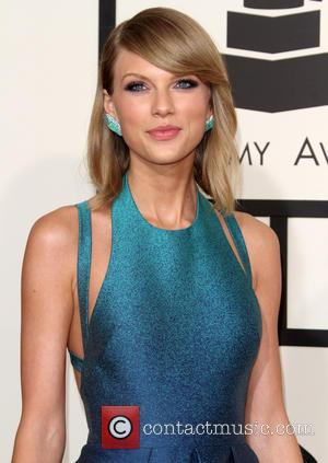 Taylor Swift and Taylor Swift - 57th Annual GRAMMY Awards held at the Staples Center - Red Carpet Arrivals at...