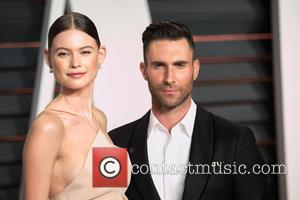 Behati Prinsloo and Adam Levine - Celebrities attend 2015 Vanity Fair Oscar Party at Wallis Annenberg Center for the Performing...