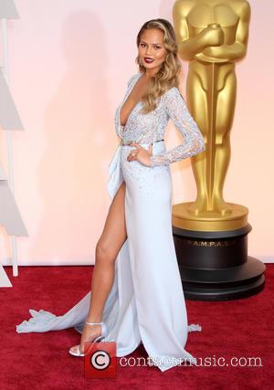 Chrissy Teigen - Hollywood's biggest stars were snapped on the red carpet as they arrived for the 87th Annual Oscars...