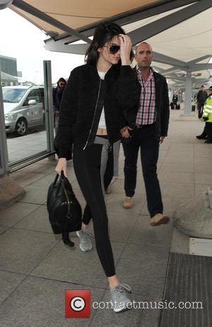 Kendall Jenner - Kendall Jenner arriving at Heathrow Airport. Kendall appeared rather camera-shy, and despite the gloomy weather, wore a...