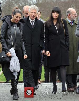 Adam Clayton and Mariana Teixeira de Carvalho - The Funeral of Rev.Jack Heaslip at St.Mary's Church Howth. Rev.Heaslip was U2's...