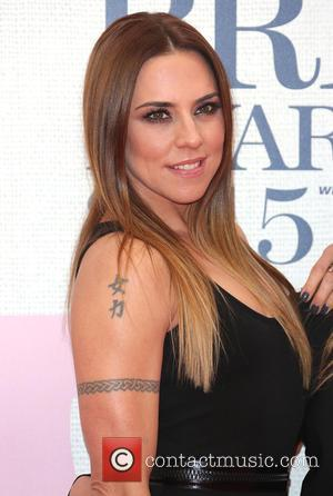 Melanie Chisholm and Mel C - A variety of stars from the music industry were photographed as they arrived at...