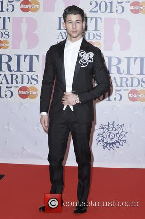 Nick Jonas - A variety of stars from the music industry were photographed as they arrived at the Brit Awards...