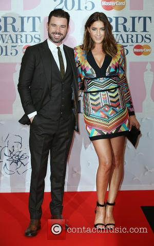 Dave Berry and Lisa Snowdon - The Brit Awards at the O2 - Arrivals at The Brit Awards - London,...