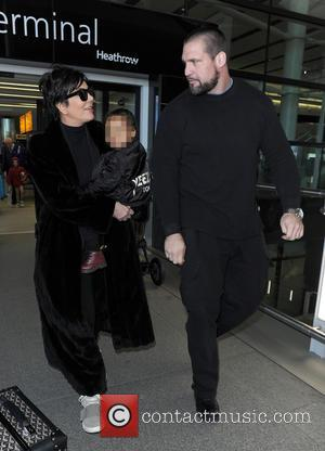 Kris Jenner and North West - Kris Jenner, wearing a pair of Kanye West x Adidas Originals Yeezy 750 Boost,...