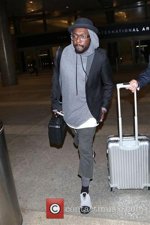 American rapper, producer and entrepreneur Will.i.am was snapped as he arrived in to LAX airport in Los Angeles, California, United...