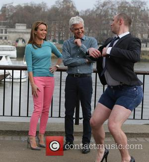 Amanda Holden - Amanda Holden and Phillip Schofield filming for This Morning Show on the Southbank - London, United Kingdom...