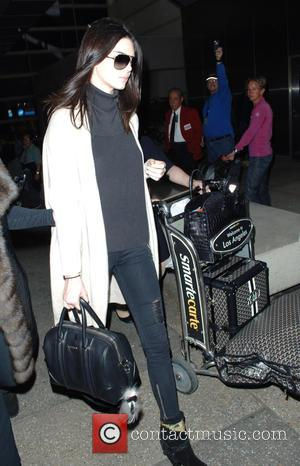 Kendall Jenner - Kris Jenner and Kendall Jenner arrive at Los Angeles International Airport (LAX) at LAX - Los Angeles,...