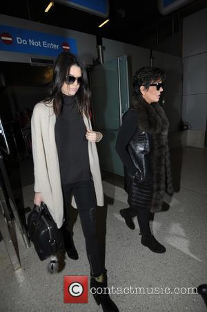 Kendall Jenner and Kris Jenner - Kris and Kendall Jenner arriving at Los Angeles International Airport. - Los Angeles, California,...