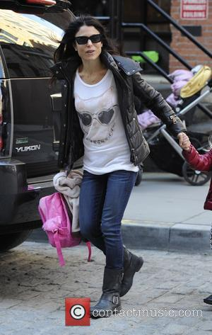 Bethenny Frankel - Bethenny Frankel picking up her daughter Bryn from school on a very windy day in New York...