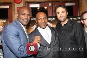 Evander Holyfield, Mike Tyson and Bert Marcus