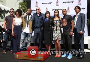 Luke Evans, Nathalie Emmanuel, Tyrese Gibson, VIN DIESEL, Michelle Rodriguez, Jordana Brewster, Ludacris and Sung Kang - Vin Diesel's hand-print...