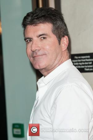 Simon Cowell All But Confirms Louis Walsh's X-Factor Exit