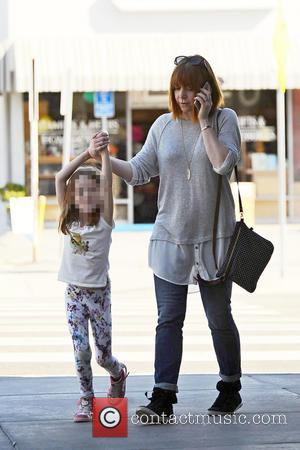 Alyson Hannigan - Alyson Hannigan holding hands with her daughter as they go shopping - Los Angeles, California, United States...