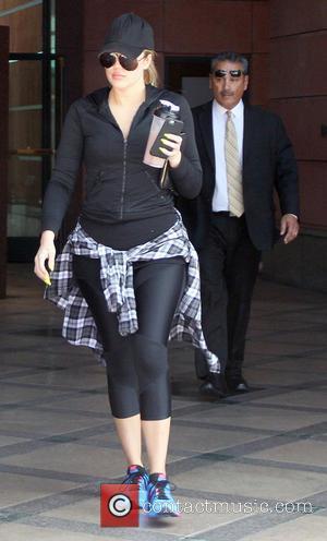 Khloe Kardashian - Khloe Kardashian goes to a salon in Beverly Hills wearing black sportswear with matching baseball cap and...