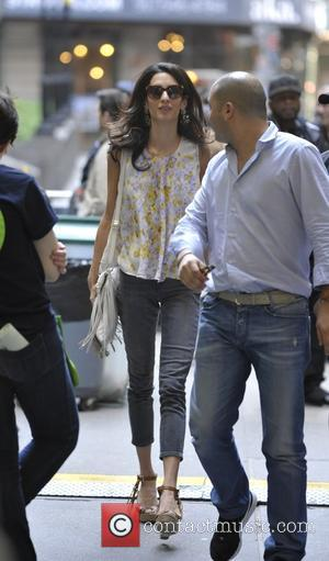Amal Clooney - Amal Clooney visits her husband George Clooney on the set of 'Money Monsters' - Manhattan, New York,...