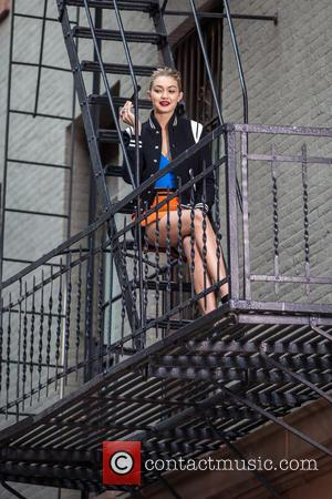 Gigi Hadid - Adriana Lima and Gigi Hadid modelling on a photo shoot for Maybelline on the streets of New...