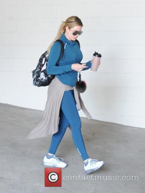 Khloe Kardashian - Khloe Kardashian leaves the gym in Hollywood wearing coordinated blue jogging sportswear - Los Angeles, California, United...