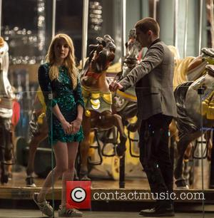 Emma Roberts and Dave Franco - Emma Roberts and Dave Franco film a scene on a carousel for their new...