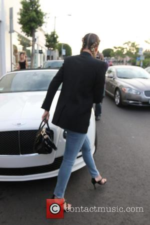Khloé Kardashian - Khloe Kardashian shopping at Dash store in West Hollywood with her hair braided into pigtails and carrying...
