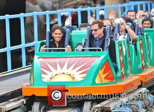 Bob Saget - Bob Saget holds hands with a female companion while riding the California Screamin roller coaster at Disneyland....