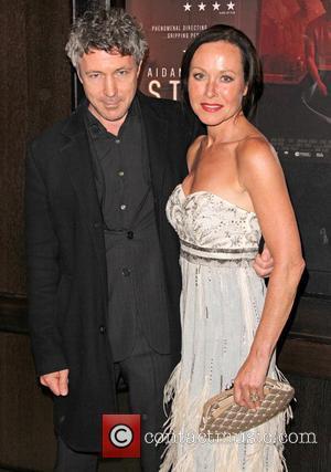 Aidan Gillen and Amanda Mealing