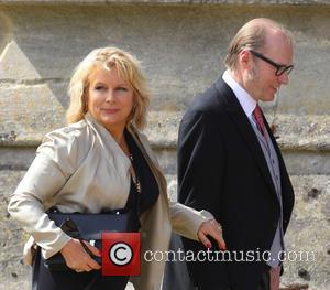 Jennifer Saunders and Adrian Edmondson - The wedding of Geri Halliwell and Christian Horner at St Mary's Church in the...