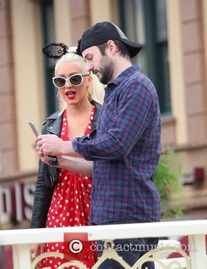 Christina Aguilera and Matthew Rutler - American pop star Christina Aguilera appears to be having a great time while wearing...