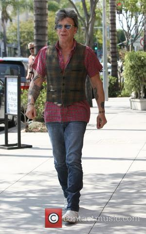 Mickey Rourke - Mickey Rourke leaves Cafe Roma in Beverly Hills - Los Angeles, California, United States - Saturday 23rd...