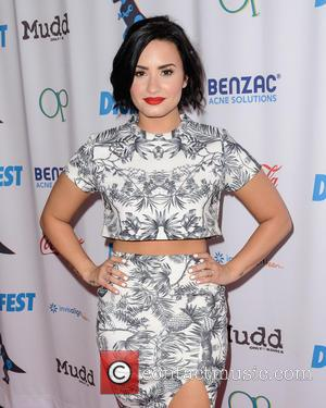 Demi Lovato Defends Saucy Magazine Shoot
