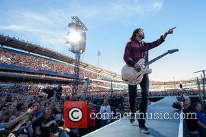 Foo Fighters' Dave Grohl Pranks Gothenburg Crowd With Broken Leg Stunt
