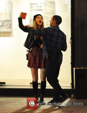 Melissa Benoist and Gabriel Chavarria - Supergirl Melissa Benoist spotted acting drunk in the streets of downtown Los Angeles for...