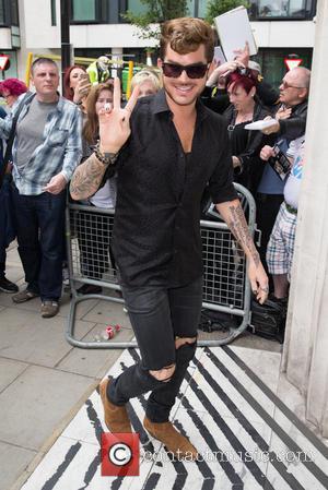 Adam Lambert - Adam Lambert arriving at the Radio 2 studios at BBC Western House - London, United Kingdom -...
